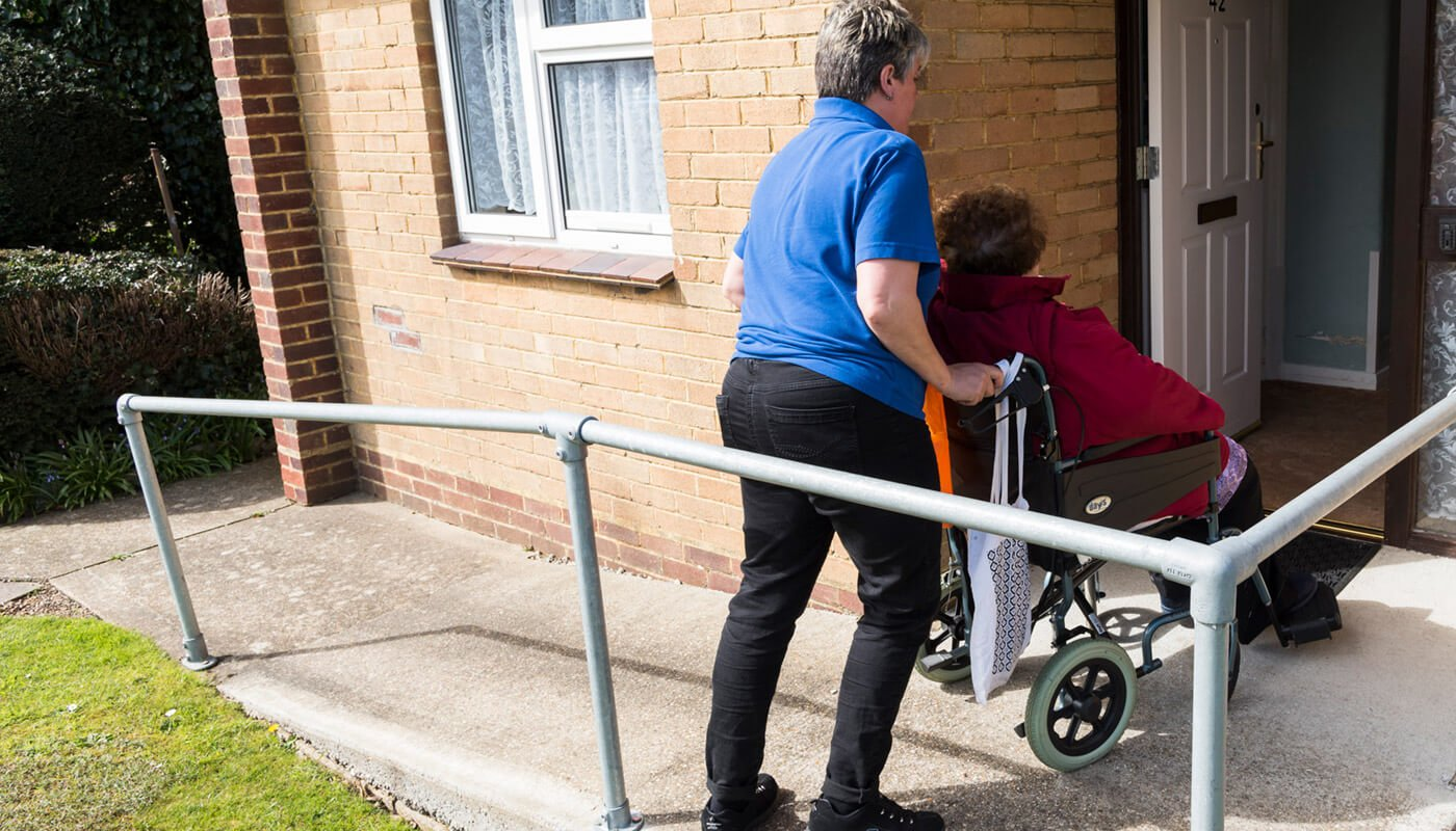 Carer with elderly woman in wheelchair
