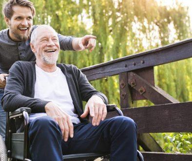 Horizon Home Carer with elderly man in wheelchair